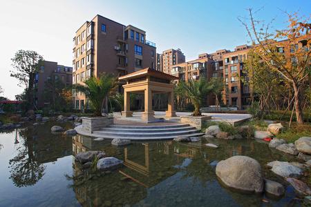 gazebo: Gazebo and pond in front of buildings
