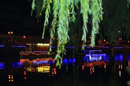 river boat: River boat lighted parade event Editorial