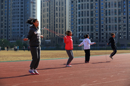 13 14 years: Girls skipping rope on Gulin town middle schools running track Editorial