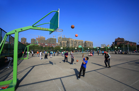 12 13: Students playing basketball in Gulin town middle school