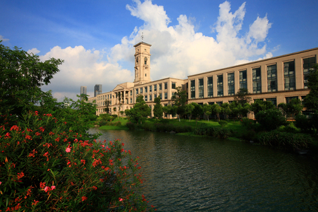 higher education: Building beside the lake in Yinzhou Higher Education Park Editorial