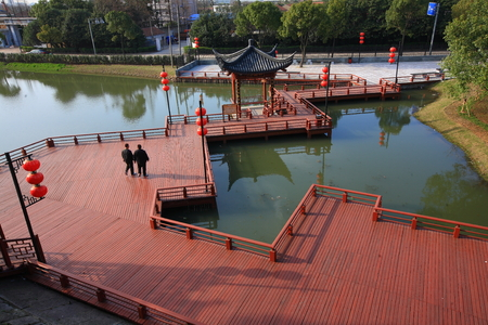 local landmark: Two men walking on the wooden boardwalk over the water