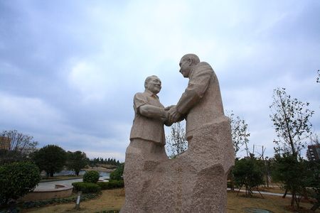 human likeness: Human likeness sculptures holding hand