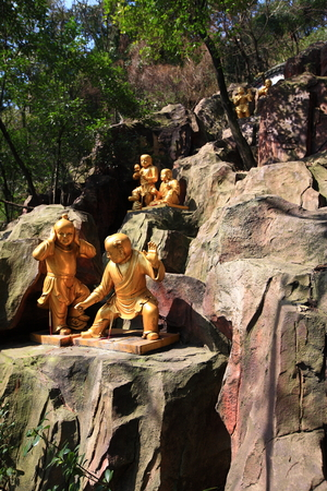 local landmark: Golden sculptures on a rocky wall