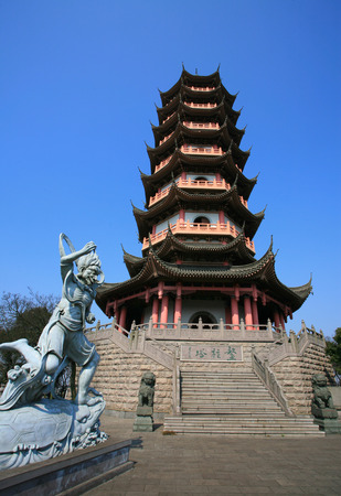 human likeness: A pagoda tower with a sculpture in the park