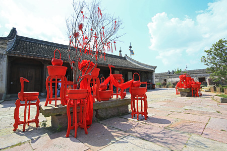 chinese traditional house: Red wooden decoration in front of chinese traditional house