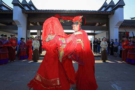 chinese courtyard: Newlyweds in Chinese traditional wedding costume at Zheng seventeen courtyard