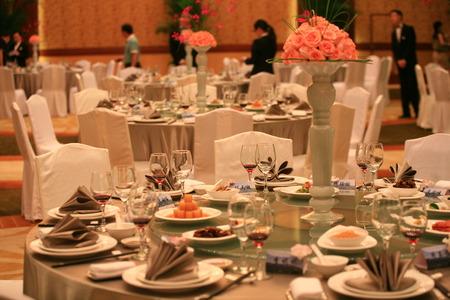 restaurant tables: Flower arrangement on restaurant table Editorial