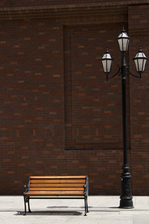 unoccupied: vacant chair and street lamp