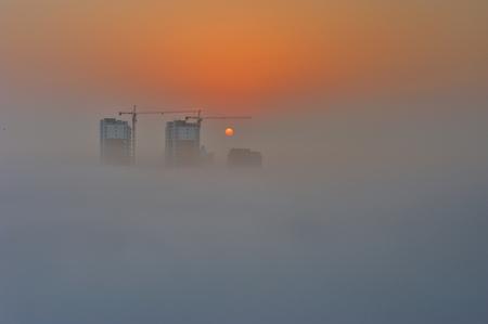 according: According rise sunrise clouds Stock Photo