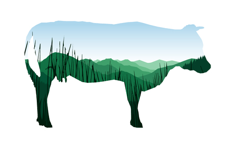 Silhouette of cow with mountain landscape.