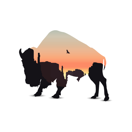 Silhouette of buffalo with western rocks.