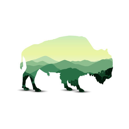 Silhouette of bison with mountain hills.
