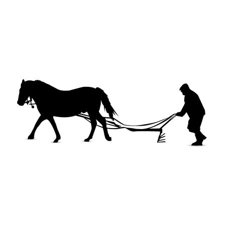 馬で耕す田舎の男のシルエット。