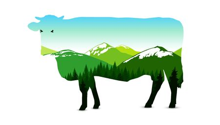 Silhouette of cow with panorama of mountains. Snowy peaks. Natural shades.
