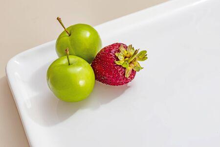 green plums with strawberry Stok Fotoğraf