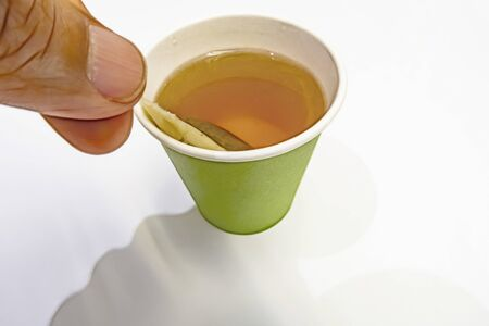 tea bag in paper cup Stok Fotoğraf - 128062448