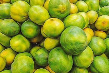 green ripe mandarin oranges