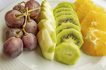 mixed fruits in white plate