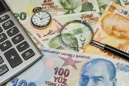 close up turkish lira banknotes with clock, magnifier and calculator Stock fotó
