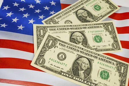 close up united states dollar banknotes on flag of United States background