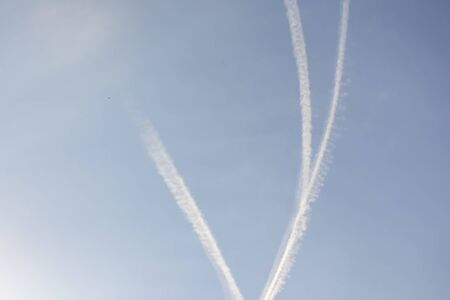 jet fuel trail left by planes at the blue sky