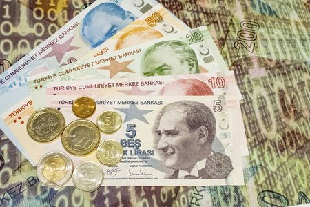 close up turkish lira banknotes and coins on background