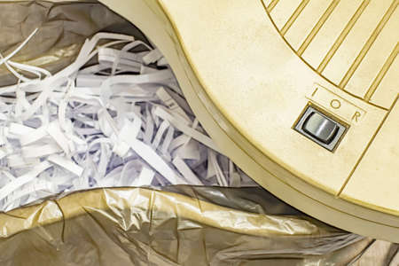 istanbul,turkey-july 2,2020. close up paper shredder and cut papers in office.