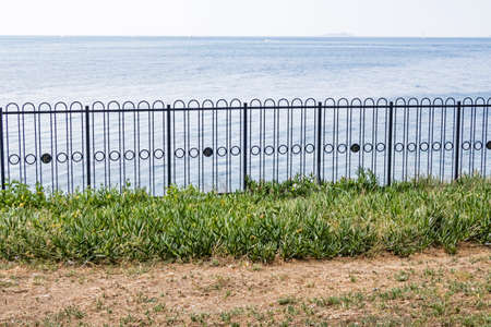 fence on the beach and seascape