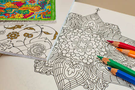 istanbul, turkey-july 27,2020.Mandala art for painting with colored crayons.