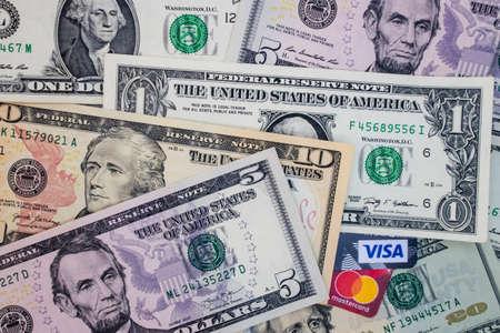 istanbul,turkey january 27,2021.close up visa and mastercard credit cards with US dollar banknotes Banco de Imagens - 163757197