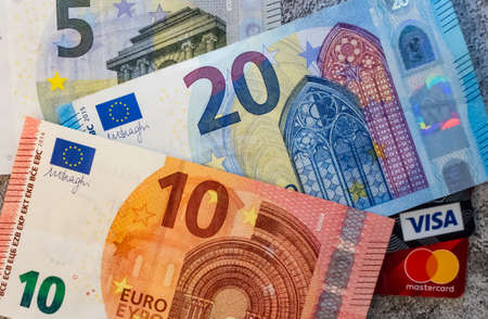 istanbul,turkey january 27,2021.close up visa and mastercard credit cards with Euro banknotes