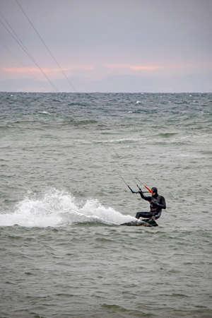 yesilkoy, istanbul, turkey-february 18,2021.sportsman doing kitesurfing in marmara sea and in winter season in istanbul.