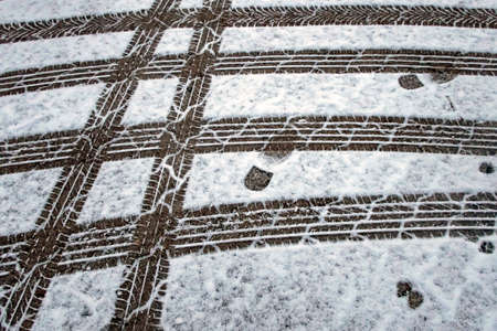 Snow and tire tracks on the road in winter Banco de Imagens - 164420179