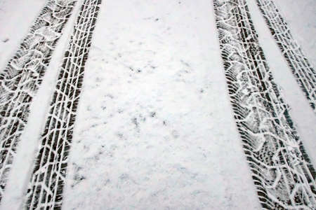 Snow and tire tracks on the road in winter Banco de Imagens