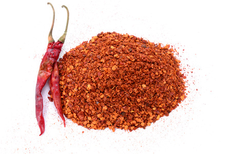pepper flakes: Crushed Red Chili Pepper flakes isolated on white background