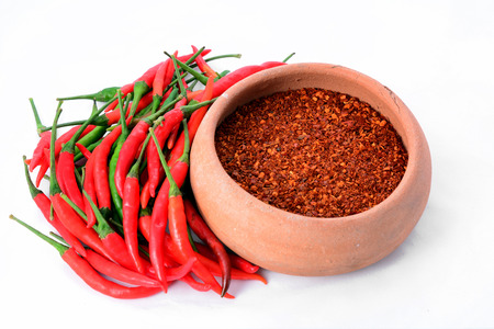 red chilly: red chillies with red chilly powder on white background