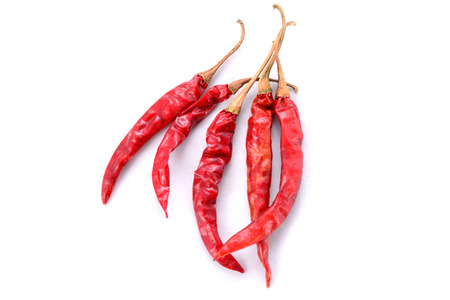 crushed red peppers: Red dry chillie isolated on white background Stock Photo