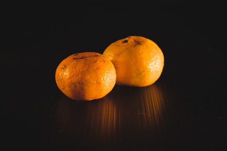 Fresh sweet orange in the dark