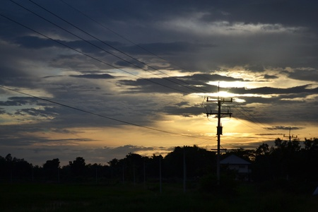 Power pole with sunset photo