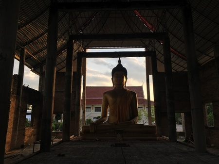 construction: The golden Buddha in the ruin temple.
