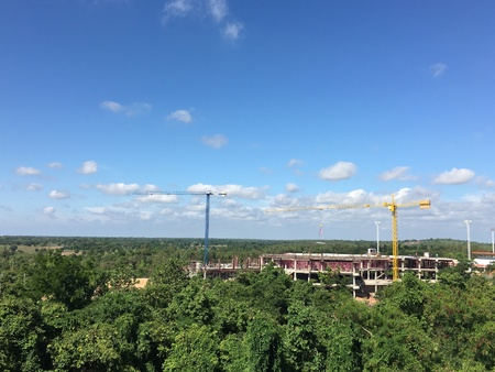 construction: The construction site placed in the forest and the blue sky. Stock Photo