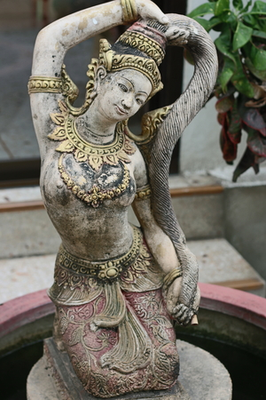 mother earth: Old Thai Mother Earth statue.