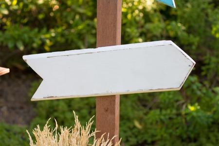 White wood arrow sign.