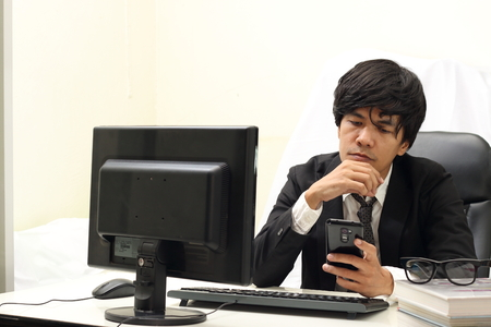 working on computer: Businessman Working On Computer