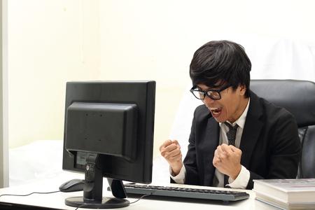 operaia: Businessman Working On Computer