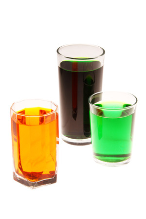 rainbow cocktail: colorful water in the glasses