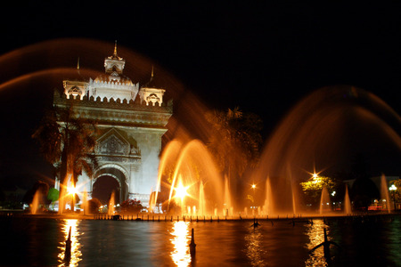 vientiane: Patuxai victory monument with musical fountain in front at Vientiane, Loas Stock Photo