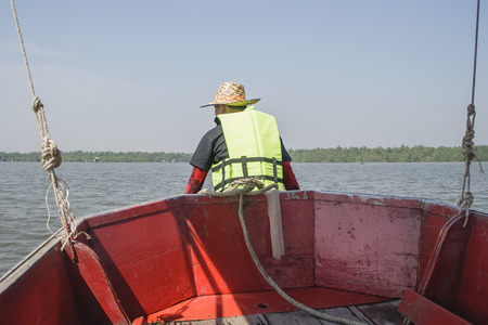 lifejacket: Young man wearing lifejacket on a boat