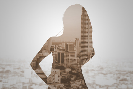 vintage woman: Double exposure of woman and cityscape, vintage colored tone